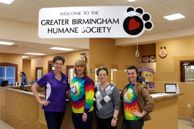 Peggy Cropp (FCDF), Laura Brinkman (AL SNC), Karen Peterlin (GBHS) and Dani Pelt (AL SNC) take a break from working to pose for a photo.